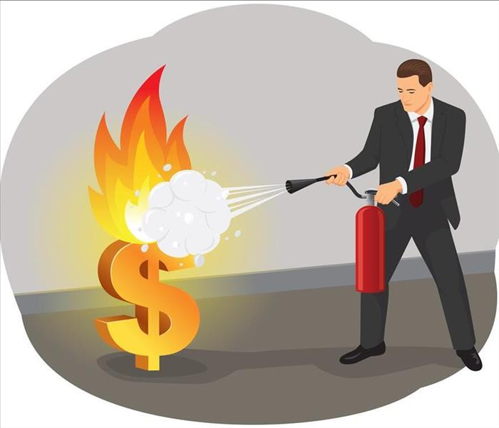 suited man using a fire extinguisher putting out a $ fire